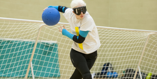 Image of a Goalball player throwing