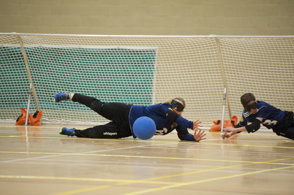 Image of a Goalball player saving in front of goal