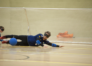 Goalball player defending the goal